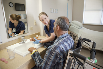 nurse helping senior patient