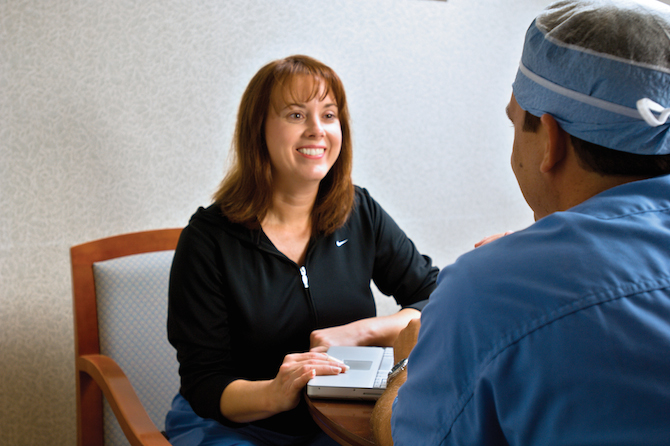 patient speaking to a nurse